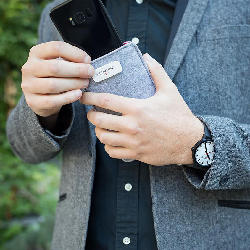 Image of person using packaging as phone cover